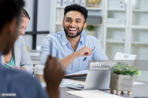 businessman laughs while meeting with colleagues - indian stock pictures, royalty-free photos & images