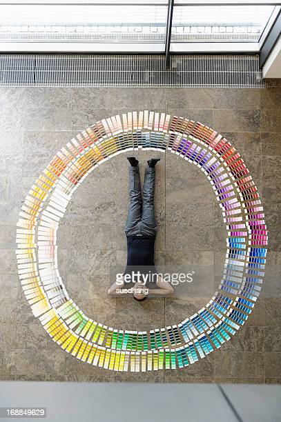 Businessman laying with paint swatches