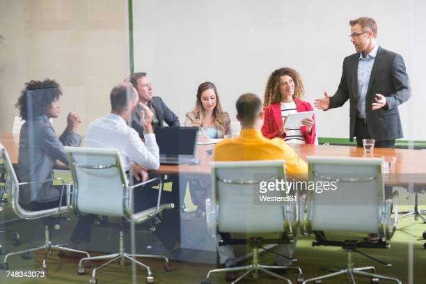 Businessman leading a meeting in boardroom