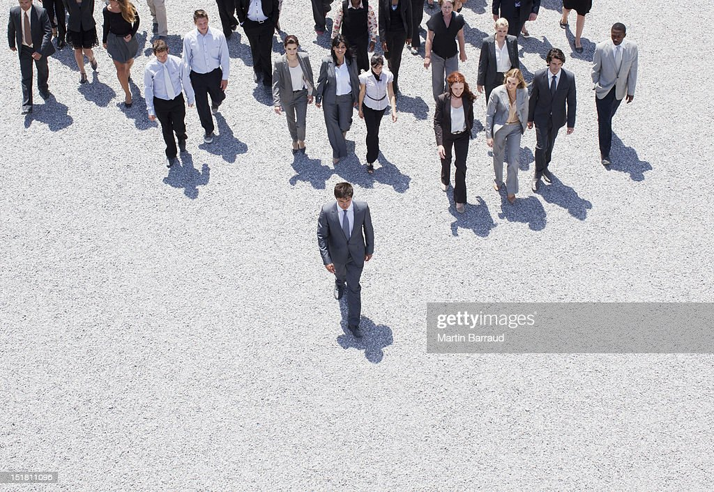 Businessman leading business people : Stock Photo
