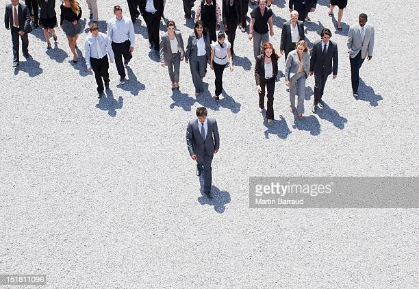 businessman leading business people - following stock pictures, royalty-free photos & images