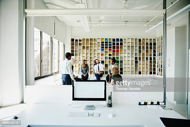 Businessman leading discussion during team meeting