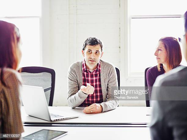 Businessman leading discussion in conference room