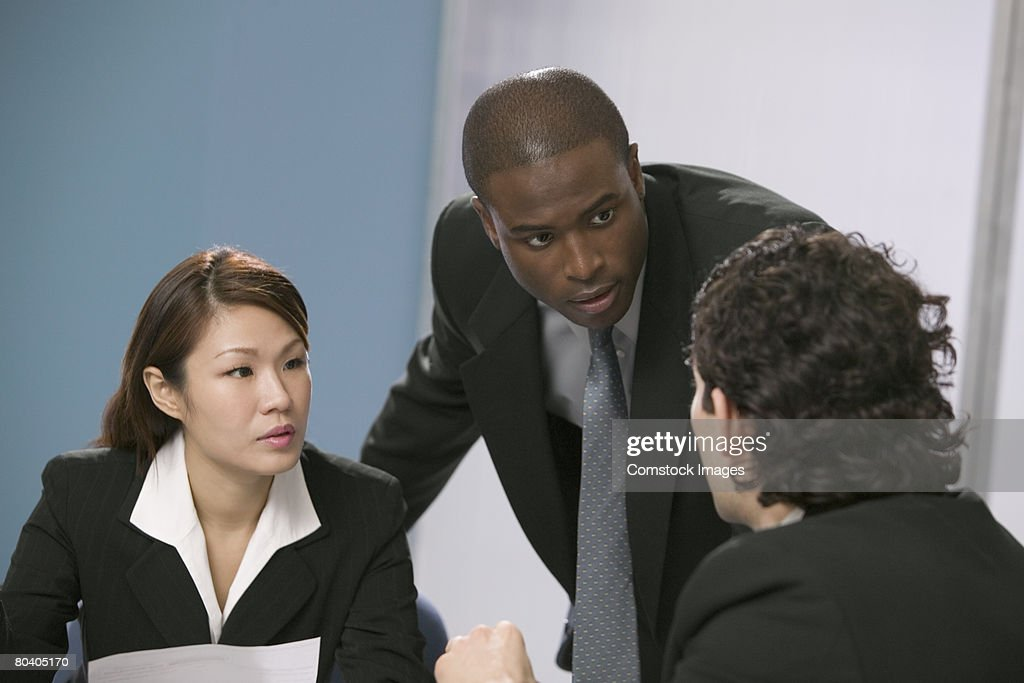Businessman leading discussion with businesspeople : Stock Photo
