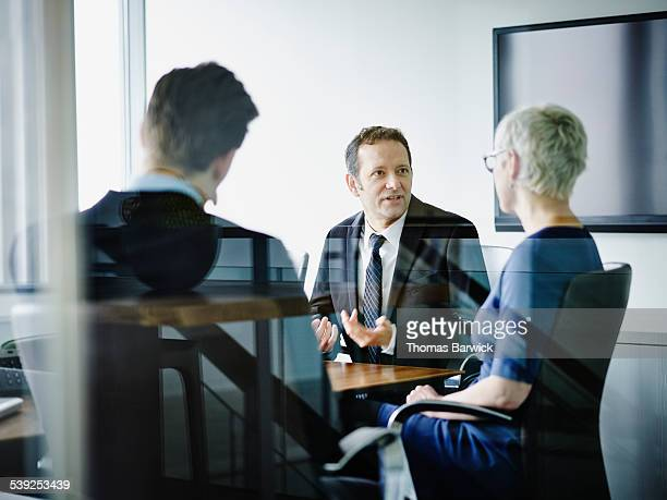 Businessman leading discussion with colleagues