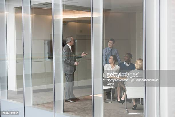 businessman leading meeting in conference room - cef do not delete stock pictures, royalty-free photos & images