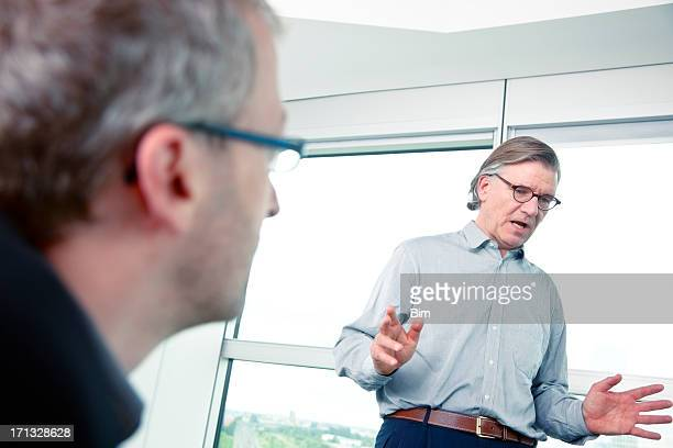 Businessman Leading Meeting, One of Listeners Hearing