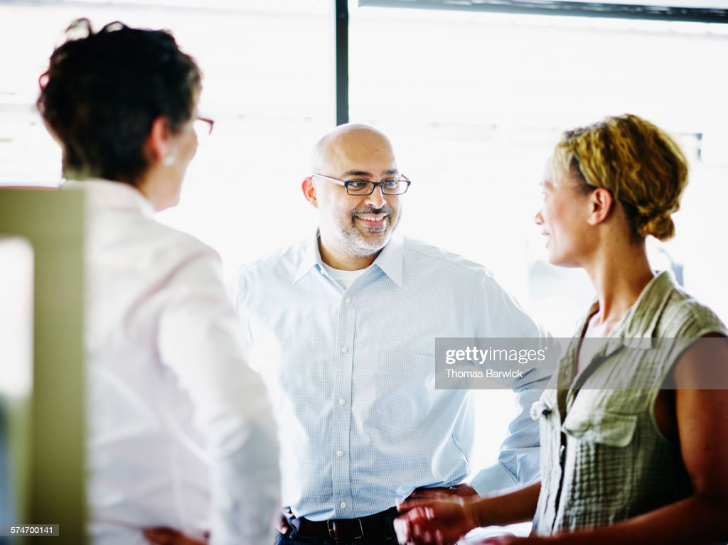 Businessman leading project meeting with coworkers : Stock Photo