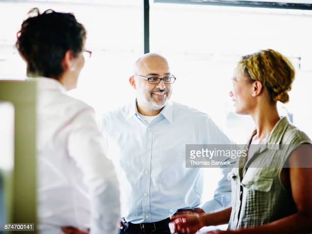 Businessman leading project meeting with coworkers