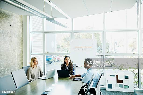 Businessman leading team meeting in office