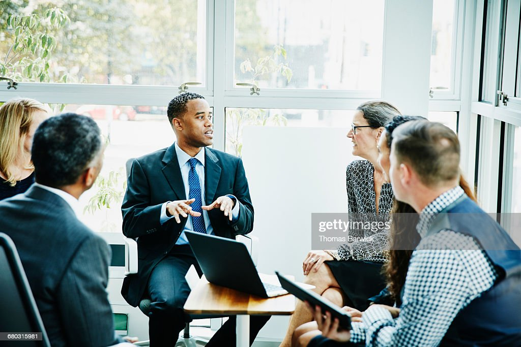 Businessman leading team meeting in office : Stock Photo