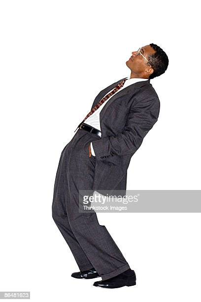Businessman leaning back and looking up