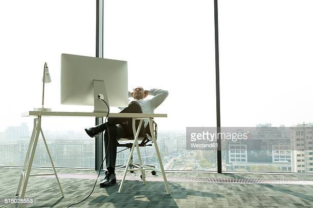 Businessman leaning back in new office