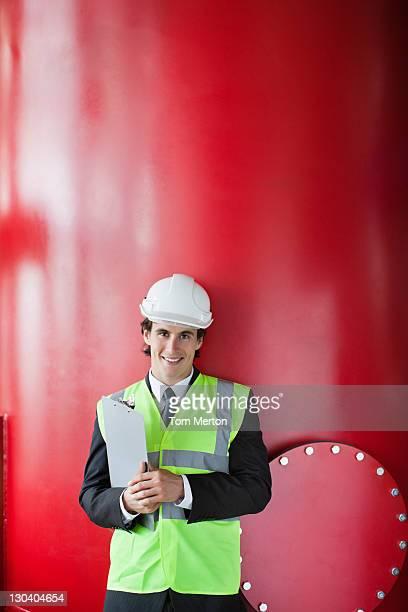 Businessman leaning on tank