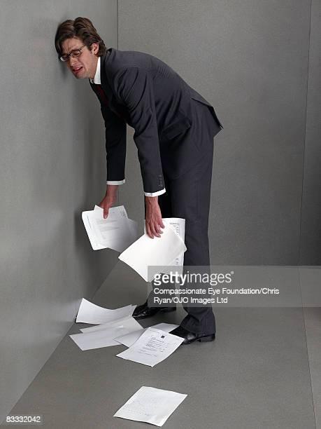 "businessman leans against wall, crying - ""compassionate eye"" fotografías e imágenes de stock"