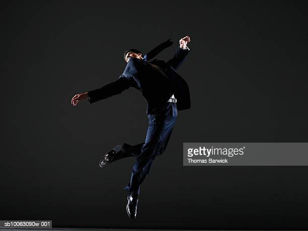 businessman leaping, arms outstretched - ジャンプする ストックフォトと画像