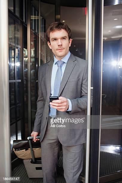 Businessman leaving through revolving door