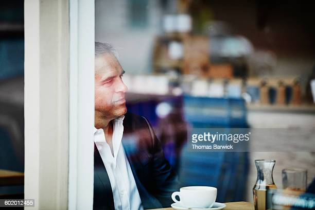 Businessman listening during meeting in cafe