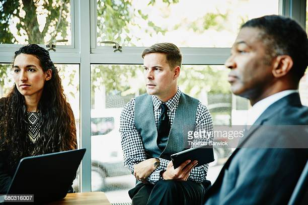 Businessman listening during meeting in office