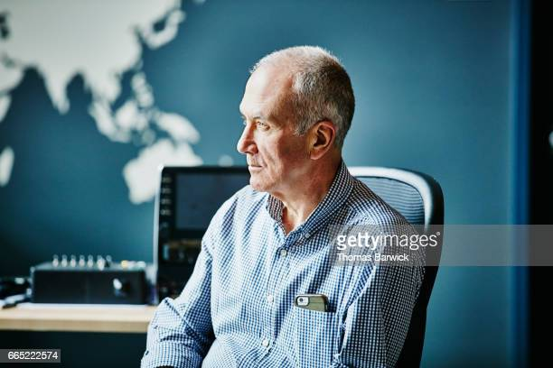 Businessman listening during project discussion in high tech office