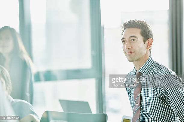 Businessman listening during project meeting