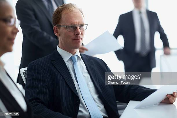 Businessman listening to colleague in meeting