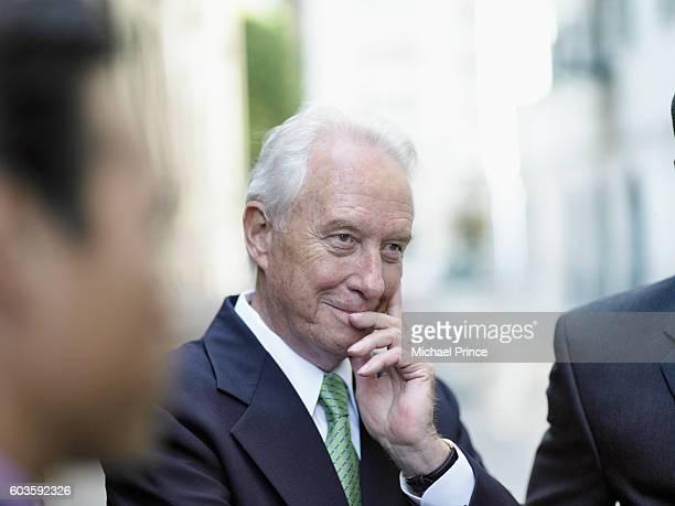 Businessman Listening to Conversation