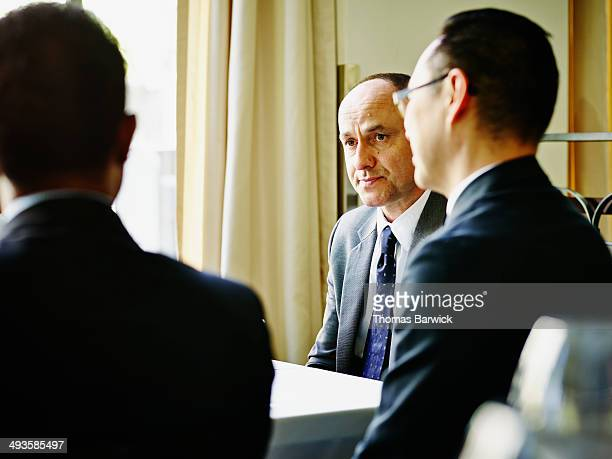 Businessman listening to meeting over lunch