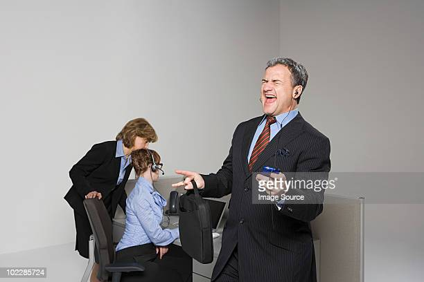 Businessman listening to MP3 player