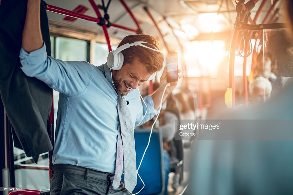 Businessman listening to music : Stock Photo