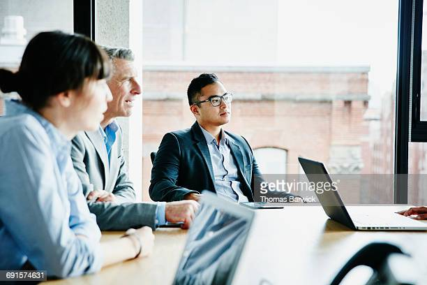 Businessman listening to presentation