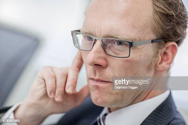 Businessman looking across table in office meeting