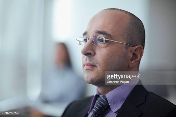 Businessman looking ahead in business meeting room