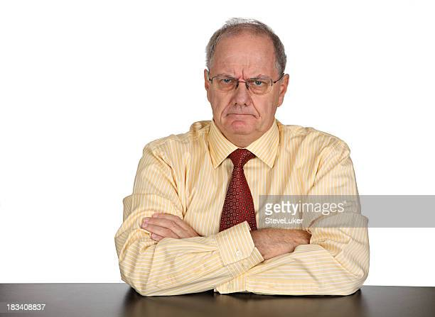 Businessman looking angrily at the camera with arms crossed