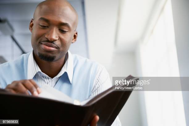 Businessman Looking at Appointment Book