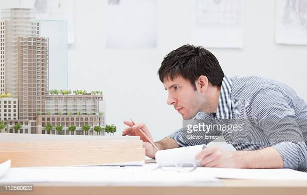 Businessman looking at architectural model