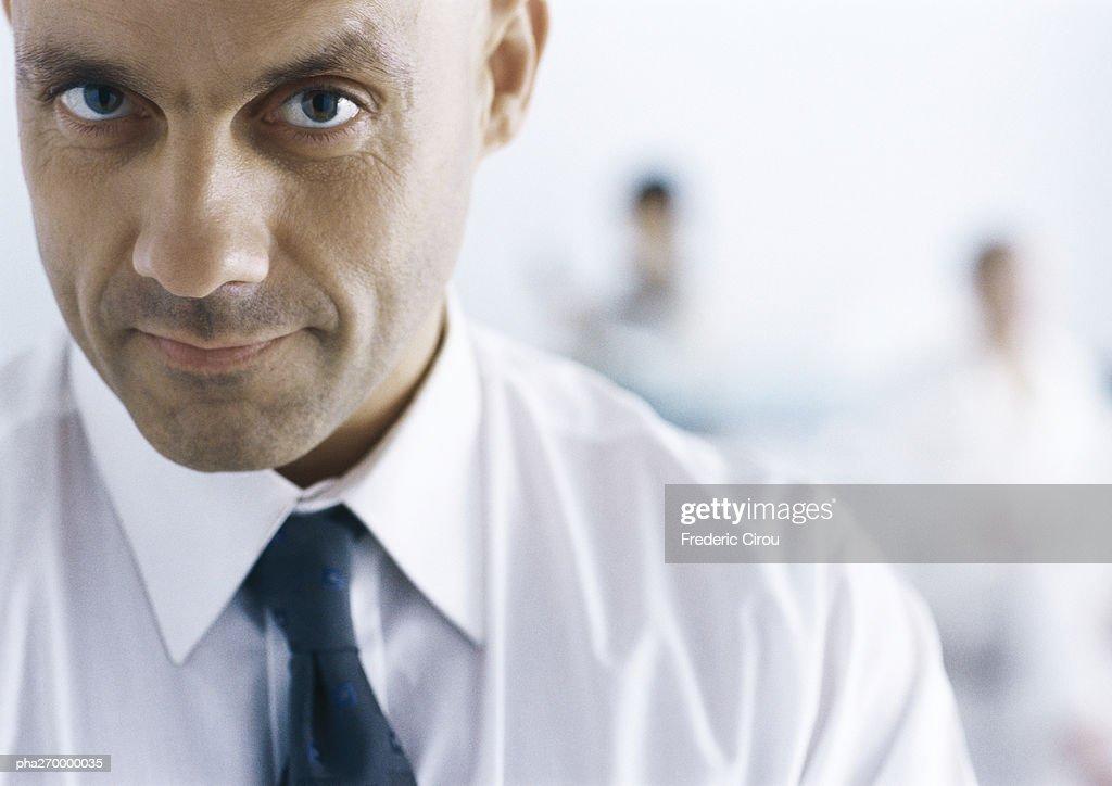 Businessman looking at camera : ストックフォト