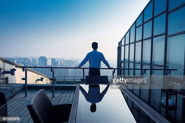 Businessman looking at cityscape