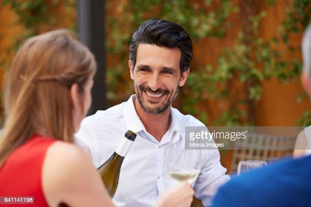 businessman looking at colleague at restaurant - 45 49 years stock pictures, royalty-free photos & images