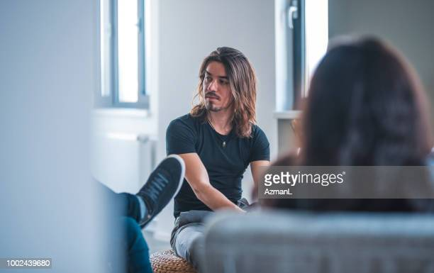 Businessman looking at colleague during meeting