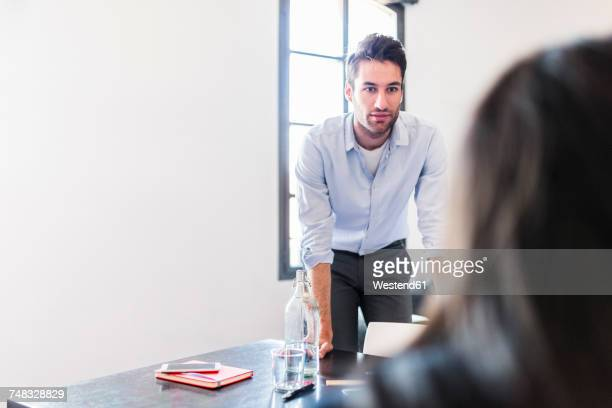Businessman looking at colleague in office