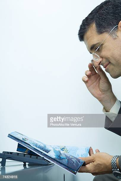 Businessman looking at comic book