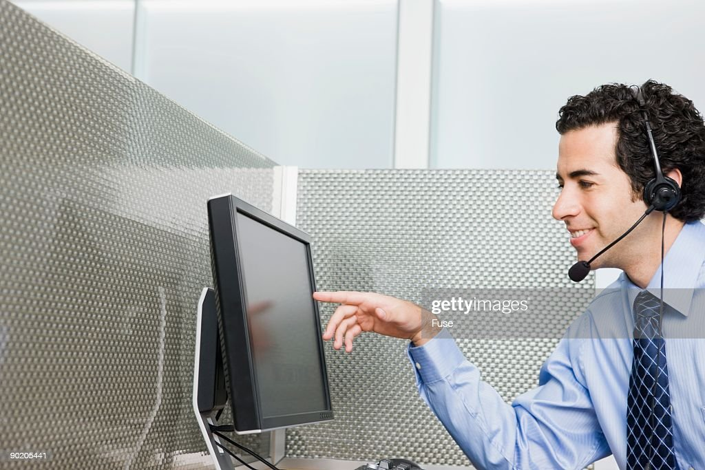 Businessman Looking At Computer Monitor High-Res Stock Photo