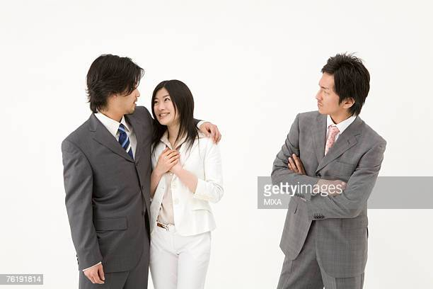 Businessman looking at couple