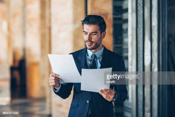 Businessman looking at documents