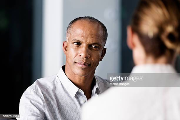 Businessman looking at female colleague