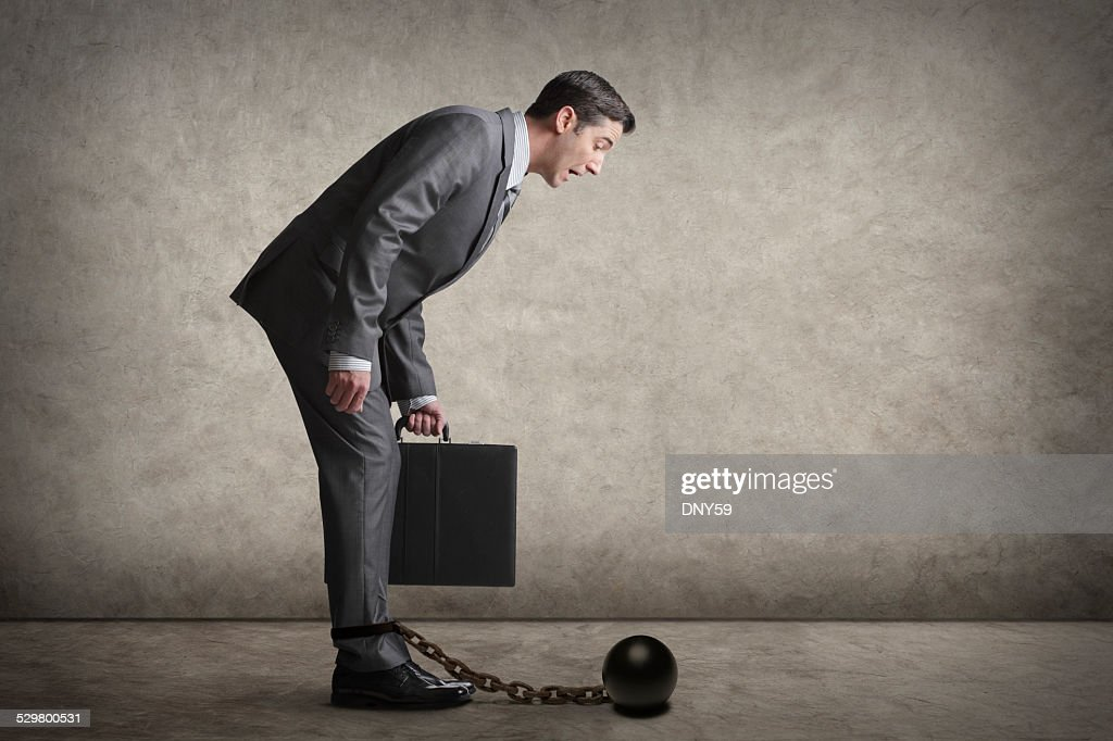 Businessman Looking At  His Ball And Chain : Stock Photo