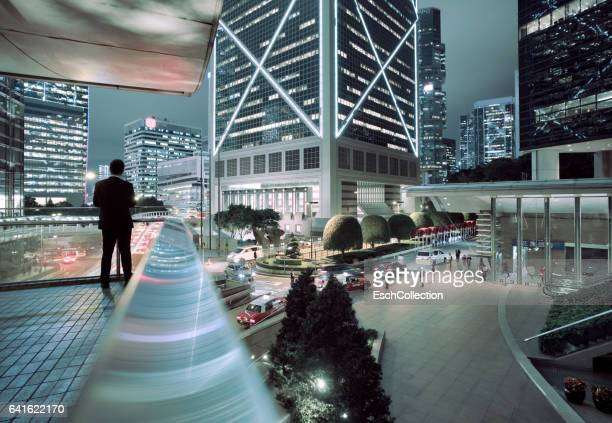 Businessman looking at illuminated Central District of Hong Kong
