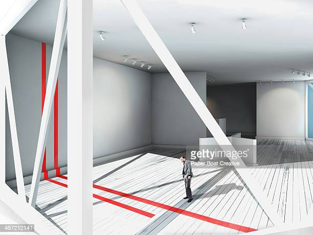 Businessman looking at red line in art gallery