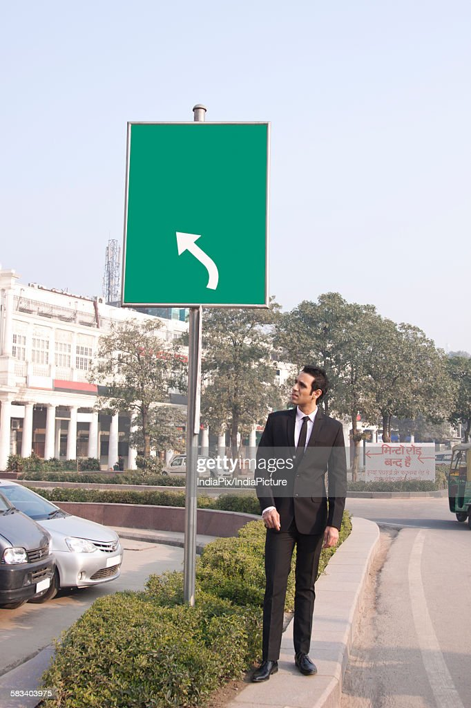 Businessman looking at something , INDIA , DELHI : Stock Photo